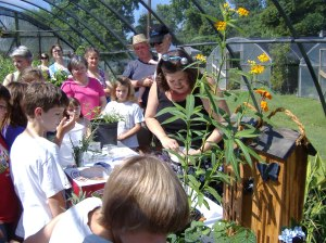Kids gathering around the Butterfly Lady. They will learn so much about nature.